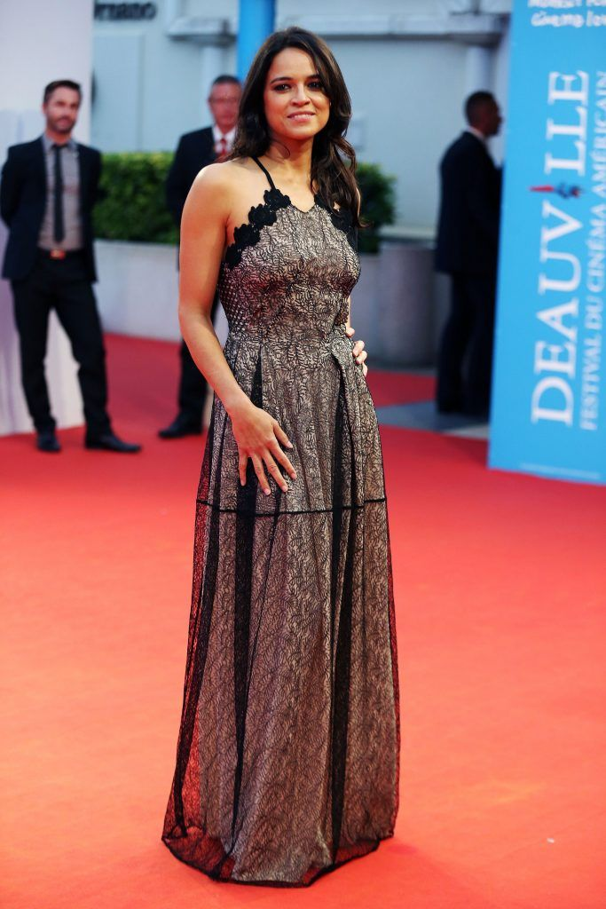 """Michelle Rodriguez poses on the red capret before the screening of the movie """"Zookeeper's wife"""" during the 43rd Deauville US Film Festival in the northwestern sea resort of Deauville,  on September 7, 2017. (Photo by CHARLY TRIBALLEAU/AFP/Getty Images)"""