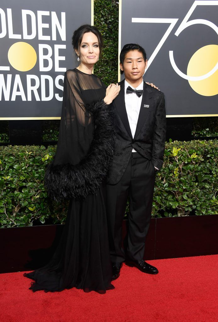 BEVERLY HILLS, CA - JANUARY 07:  Actor/director Angelina Jolie (L) and Pax Thien Jolie-Pitt attend The 75th Annual Golden Globe Awards at The Beverly Hilton Hotel on January 7, 2018 in Beverly Hills, California.  (Photo by Frazer Harrison/Getty Images)