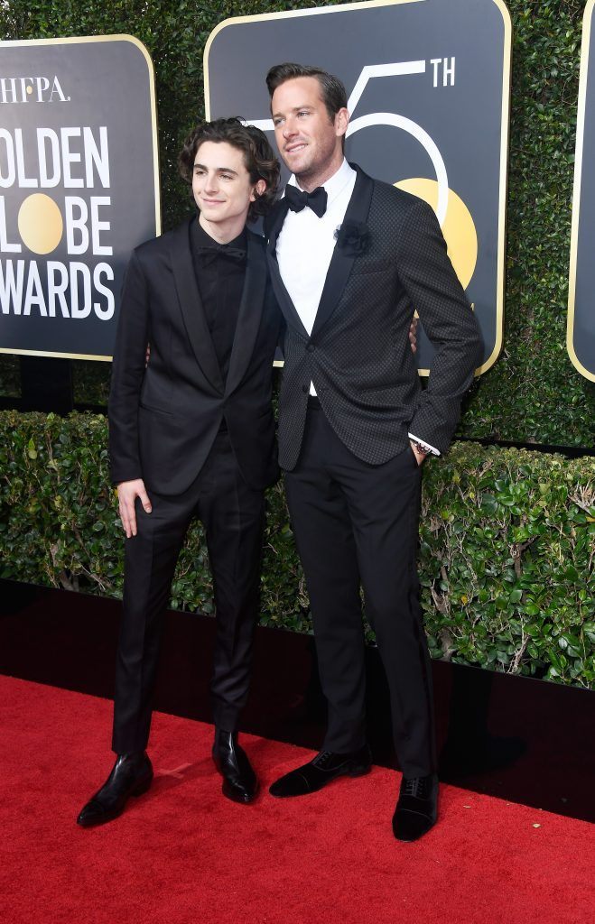 BEVERLY HILLS, CA - JANUARY 07:  Actor Timothee Chalamet (L) and Armie Hammer attend The 75th Annual Golden Globe Awards at The Beverly Hilton Hotel on January 7, 2018 in Beverly Hills, California.  (Photo by Frazer Harrison/Getty Images)