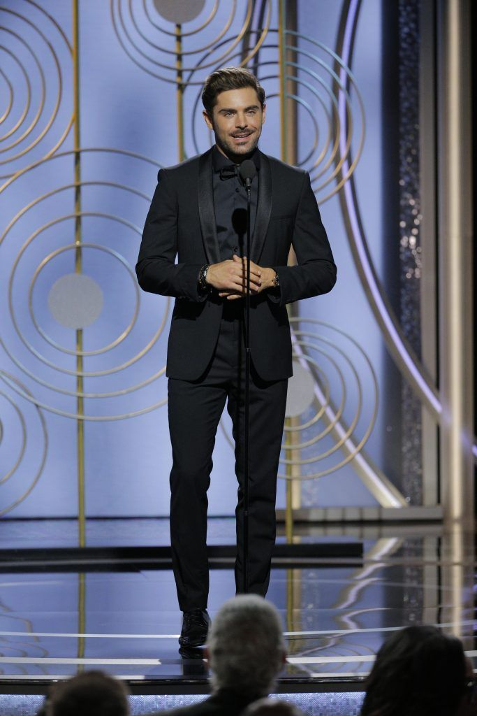 BEVERLY HILLS, CA - JANUARY 07:  In this handout photo provided by NBCUniversal,  Actor Zac Efron speaks onstage during the 75th Annual Golden Globe Awards at The Beverly Hilton Hotel on January 7, 2018 in Beverly Hills, California.  (Photo by Paul Drinkwater/NBCUniversal via Getty Images)