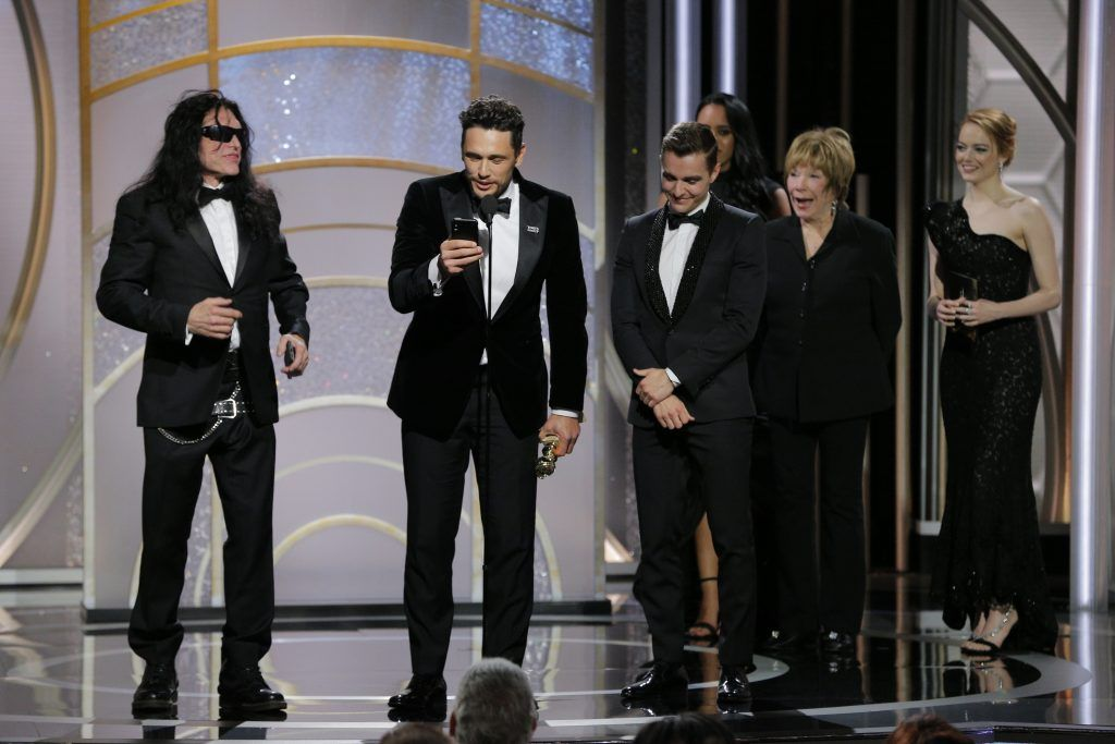 """BEVERLY HILLS, CA - JANUARY 07:  In this handout photo provided by NBCUniversal,  James Franco, with Tommy Wiseau and Dave Franco,  accepts the award for Best Performance by an Actor in a Motion Picture – Musical or Comedy for  """"The Disaster Artist"""" during the 75th Annual Golden Globe Awards at The Beverly Hilton Hotel on January 7, 2018 in Beverly Hills, California.  (Photo by Paul Drinkwater/NBCUniversal via Getty Images)"""