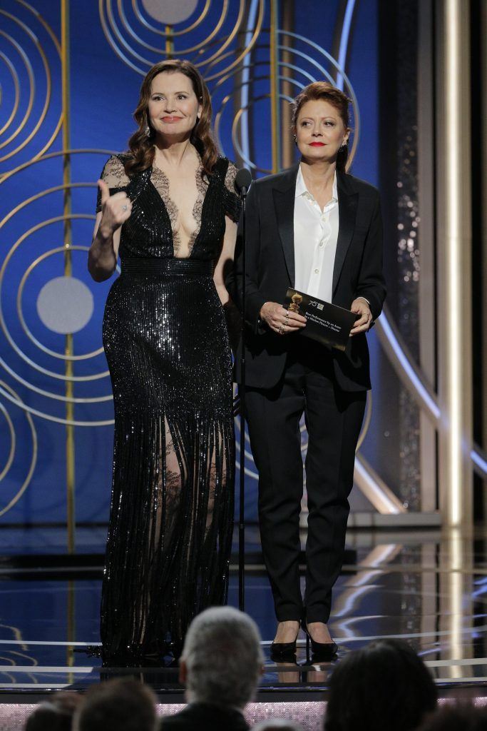 BEVERLY HILLS, CA - JANUARY 07:  In this handout photo provided by NBCUniversal,  Presenters Geena Davis and  Susan Sarandon  onstage during the 75th Annual Golden Globe Awards at The Beverly Hilton Hotel on January 7, 2018 in Beverly Hills, California.  (Photo by Paul Drinkwater/NBCUniversal via Getty Images)