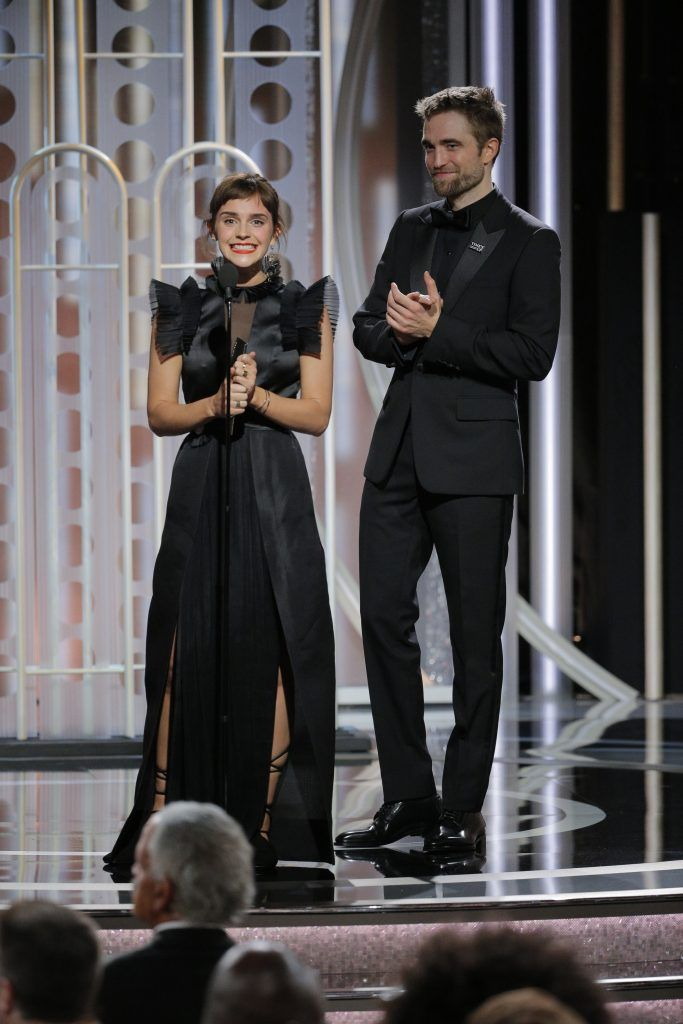BEVERLY HILLS, CA - JANUARY 07:  In this handout photo provided by NBCUniversal,  Presenters Emma Watson and Robert Pattinson speaks onstage during the 75th Annual Golden Globe Awards at The Beverly Hilton Hotel on January 7, 2018 in Beverly Hills, California.  (Photo by Paul Drinkwater/NBCUniversal via Getty Images)