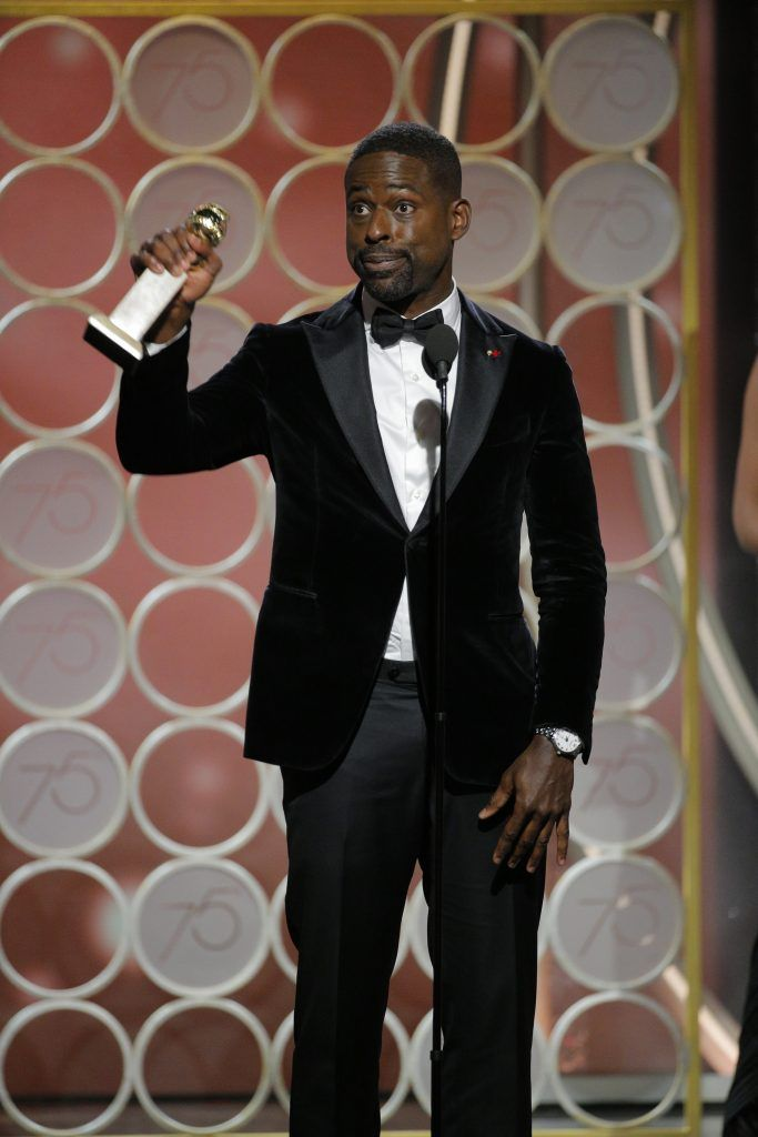 """BEVERLY HILLS, CA - JANUARY 07:  In this handout photo provided by NBCUniversal,  Sterling K. Brown accepts the award for Best Performance by an Actor in a Television Series – Drama for """"This is Us""""  during the 75th Annual Golden Globe Awards at The Beverly Hilton Hotel on January 7, 2018 in Beverly Hills, California.  (Photo by Paul Drinkwater/NBCUniversal via Getty Images)"""