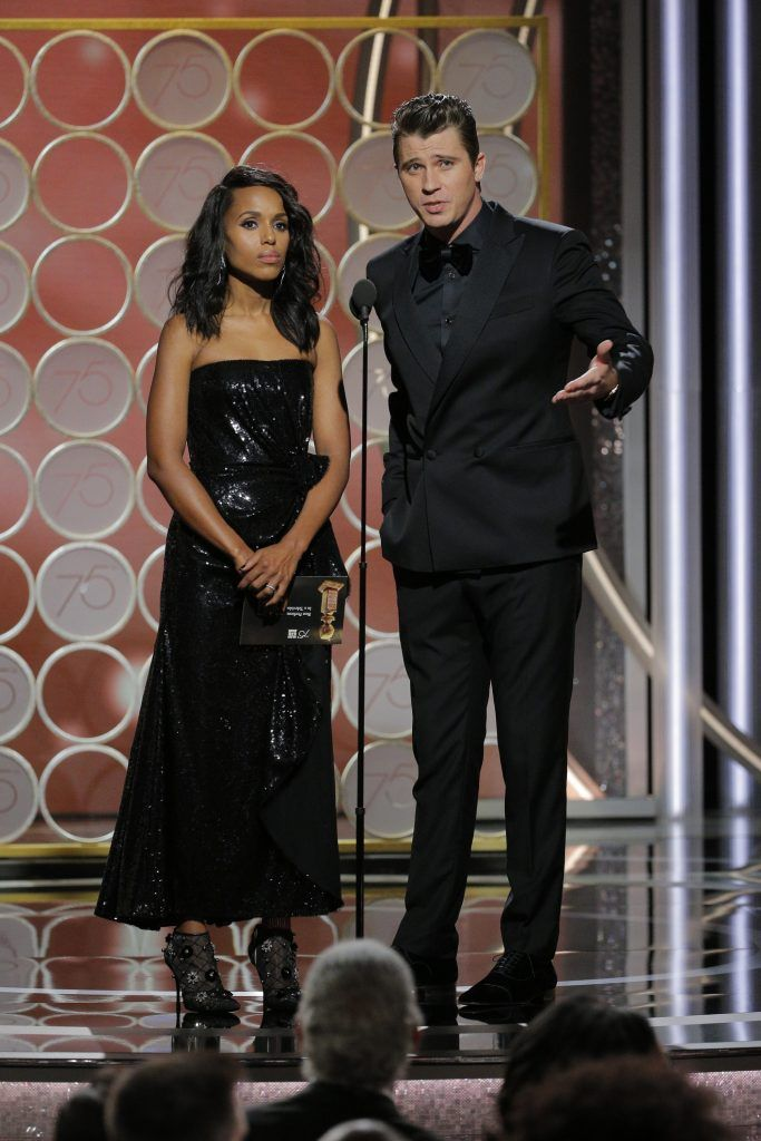 BEVERLY HILLS, CA - JANUARY 07:  In this handout photo provided by NBCUniversal, Kerry Washington and Garrett Hedlund  speak onstage during the 75th Annual Golden Globe Awards at The Beverly Hilton Hotel on January 7, 2018 in Beverly Hills, California.  (Photo by Paul Drinkwater/NBCUniversal via Getty Images)