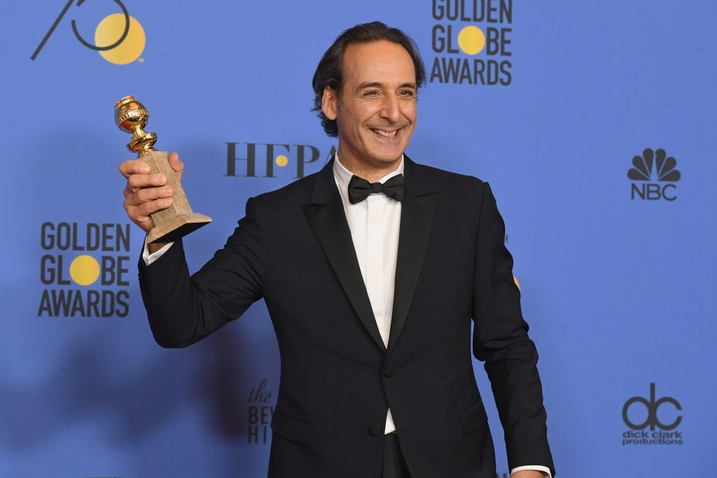 BEVERLY HILLS, CA - JANUARY 07:  Composer Alexandre Desplat poses with his award for Best Original Score Motion Picture for 'The Shape of Water' in the press room during The 75th Annual Golden Globe Awards at The Beverly Hilton Hotel on January 7, 2018 in Beverly Hills, California.  (Photo by Kevin Winter/Getty Images)