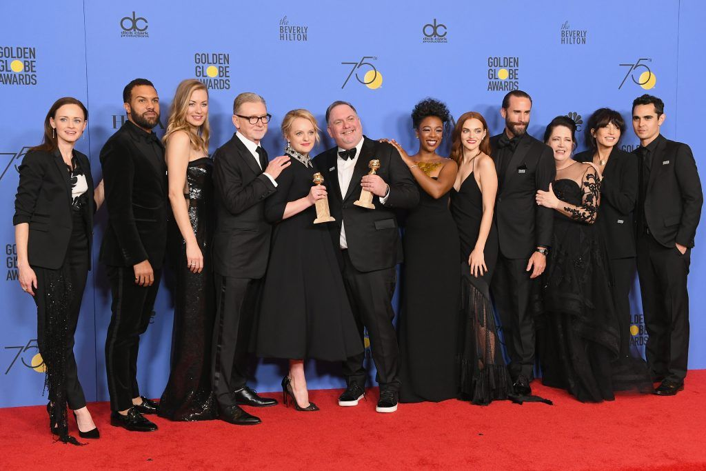 BEVERLY HILLS, CA - JANUARY 07:  (L-R) Actors Alexis Bledel, O-T Fagbenle, Yvonne Strahovski, Producers Warren Littlefield, Elisabeth Moss, Bruce Miller, actors Samira Wiley, Madeline Brewer, Joseph Fiennes, Ann Dowd, Reed Morano and Max Minghella of 'The Handmaid's Tale' pose with their awards for Best Television Series Drama in the press room during The 75th Annual Golden Globe Awards at The Beverly Hilton Hotel on January 7, 2018 in Beverly Hills, California.  (Photo by Kevin Winter/Getty Images)