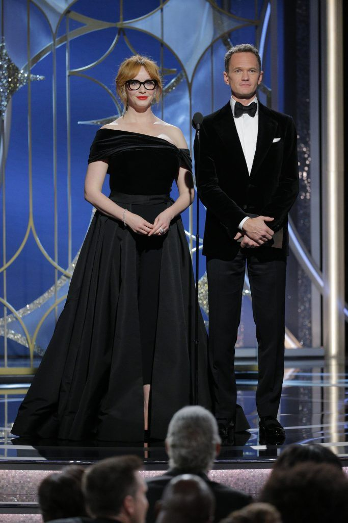 BEVERLY HILLS, CA - JANUARY 07:  In this handout photo provided by NBCUniversal, Christina Hendricks  and  Neil Patrick Harris speak onstage during the 75th Annual Golden Globe Awards at The Beverly Hilton Hotel on January 7, 2018 in Beverly Hills, California.  (Photo by Paul Drinkwater/NBCUniversal via Getty Images)