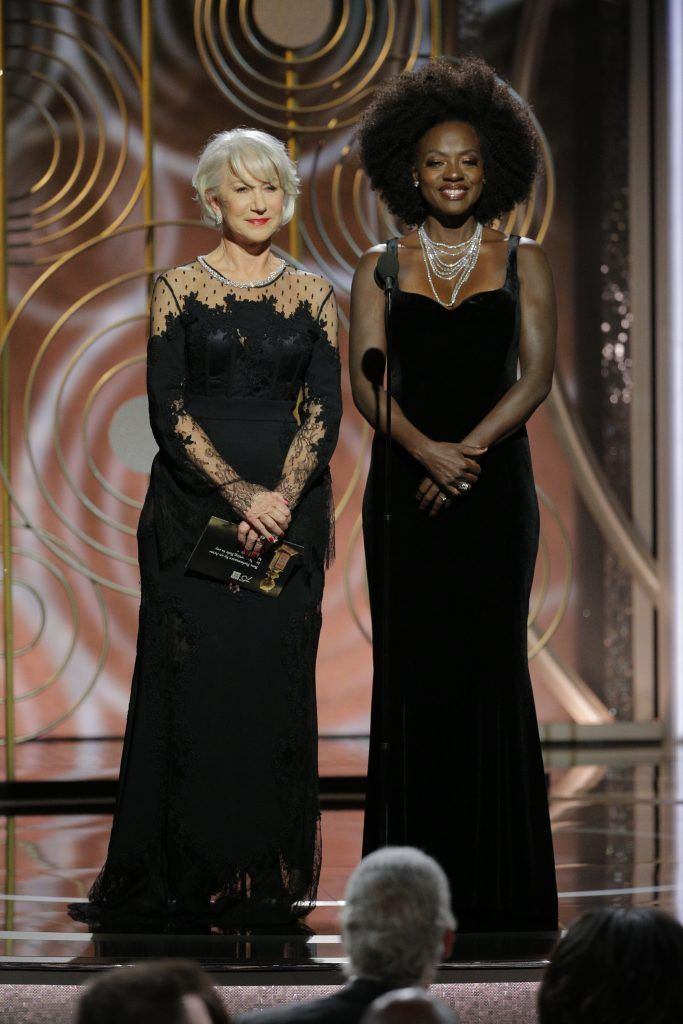 BEVERLY HILLS, CA - JANUARY 07:  In this handout photo provided by NBCUniversal,  Presenters Helen Mirren and  Viola Davis onstage during the 75th Annual Golden Globe Awards at The Beverly Hilton Hotel on January 7, 2018 in Beverly Hills, California.  (Photo by Paul Drinkwater/NBCUniversal via Getty Images)