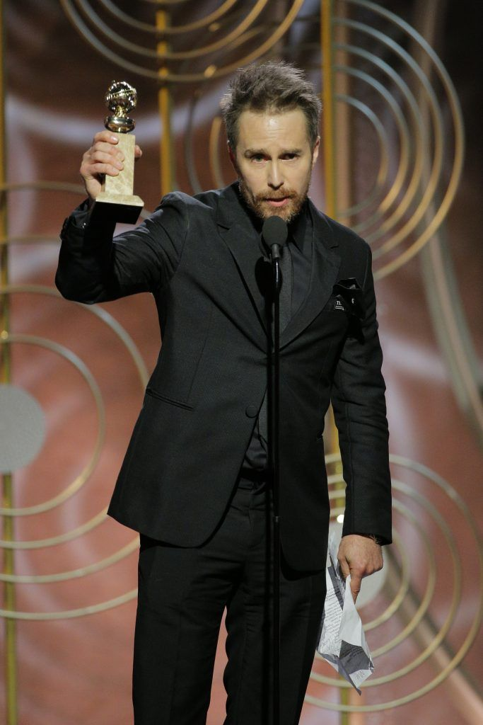 """BEVERLY HILLS, CA - JANUARY 07:  In this handout photo provided by NBCUniversal,  Sam Rockwell accepts the award for Best Performance by an Actor in a Supporting Role in a Motion Picture for """"Three Billboards Outside Ebbing, Missouri"""" during the 75th Annual Golden Globe Awards at The Beverly Hilton Hotel on January 7, 2018 in Beverly Hills, California.  (Photo by Paul Drinkwater/NBCUniversal via Getty Images)"""