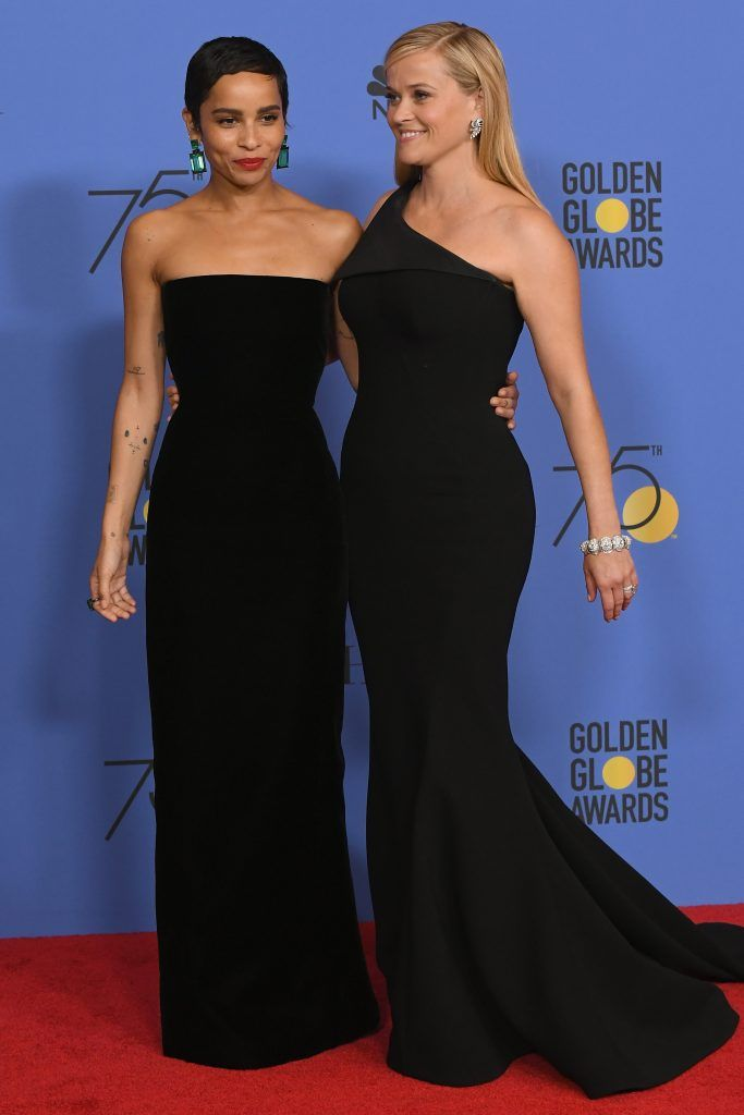 BEVERLY HILLS, CA - JANUARY 07:  (L-R) Actors Zoe Kravitz and Reese Witherspoon arrives after receiving the Best Television Limited Series or Motion Picture Made for Television award for 'Big Little Lies' in the press room during The 75th Annual Golden Globe Awards at The Beverly Hilton Hotel on January 7, 2018 in Beverly Hills, California.  (Photo by Kevin Winter/Getty Images)