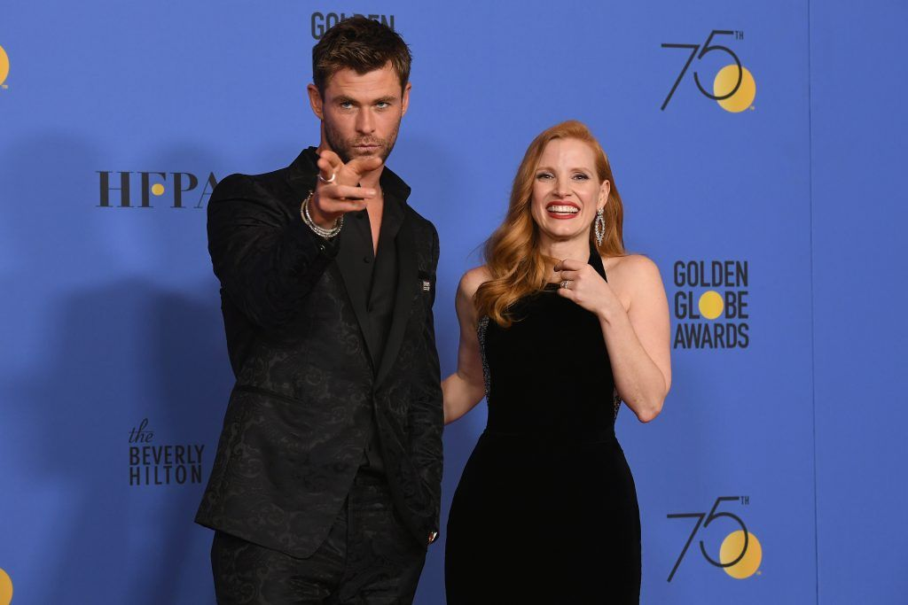 BEVERLY HILLS, CA - JANUARY 07:  Actors Chris Hemsworth and Jessica Chastain pose in the press room during The 75th Annual Golden Globe Awards at The Beverly Hilton Hotel on January 7, 2018 in Beverly Hills, California.  (Photo by Kevin Winter/Getty Images)