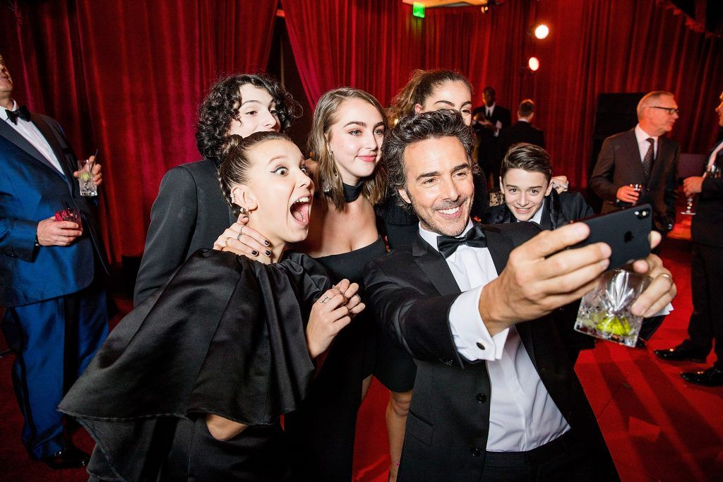 Millie Bobby Brown, Finn Wolfhard, Shawn Levy and Noah Schnapp attend the Netflix Golden Globes after party at Waldorf Astoria Beverly Hills on January 7, 2018 in Beverly Hills, California.  (Photo by Netflix via Getty Images)