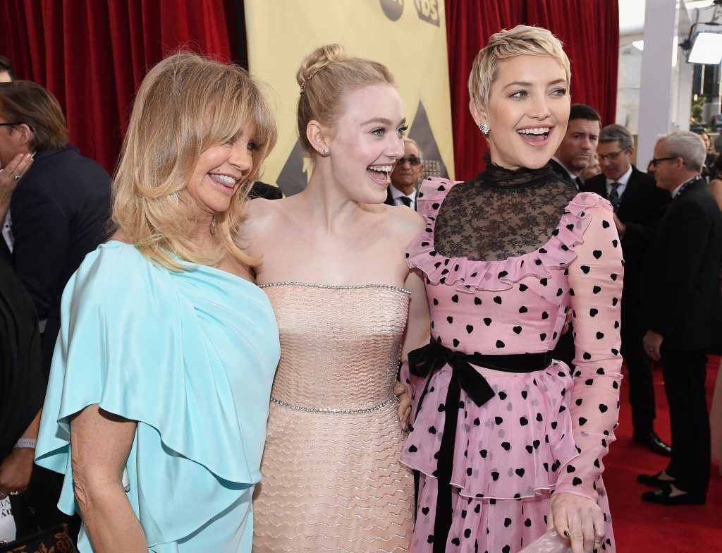 LOS ANGELES, CA - JANUARY 21:  Actors Goldie Hawn, Dakota Fanning, and Kate Hudson attend the 24th Annual Screen Actors Guild Awards at The Shrine Auditorium on January 21, 2018 in Los Angeles, California.  (Photo by Kevork Djansezian/Getty Images)