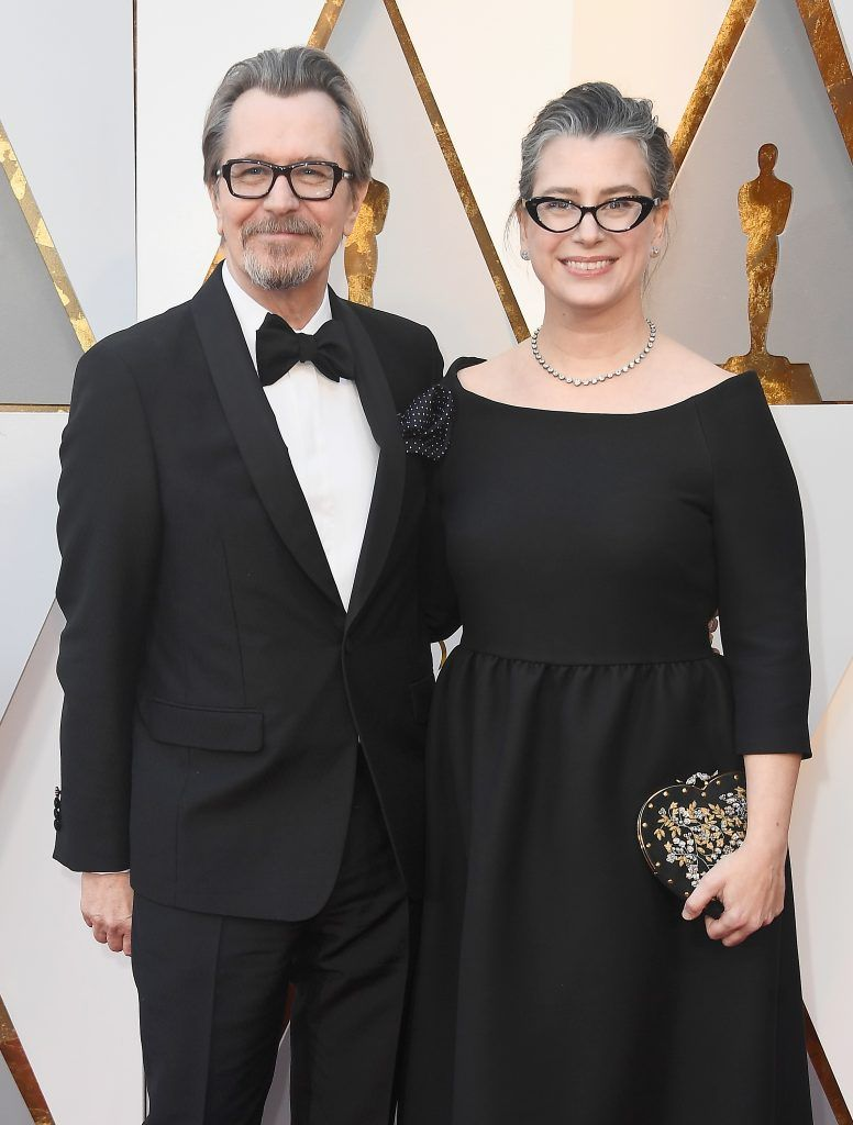 HOLLYWOOD, CA - MARCH 04:  Gary Oldman (L) and Gisele Schmidt attend the 90th Annual Academy Awards at Hollywood & Highland Center on March 4, 2018 in Hollywood, California.  (Photo by Frazer Harrison/Getty Images)