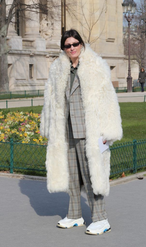 Irina Linovich poses wearing a Loewe coat, Maison Margiela suit and Balenciaga shoes before the Maison Margiela show at the Grand Palais during Paris Fashion Week Womenswear FW18/19 on February 28, 2018 in Paris, France.  Featuring: Irina Linovich Where: Paris, France When: 28 Feb 2018 Credit: WENN.com