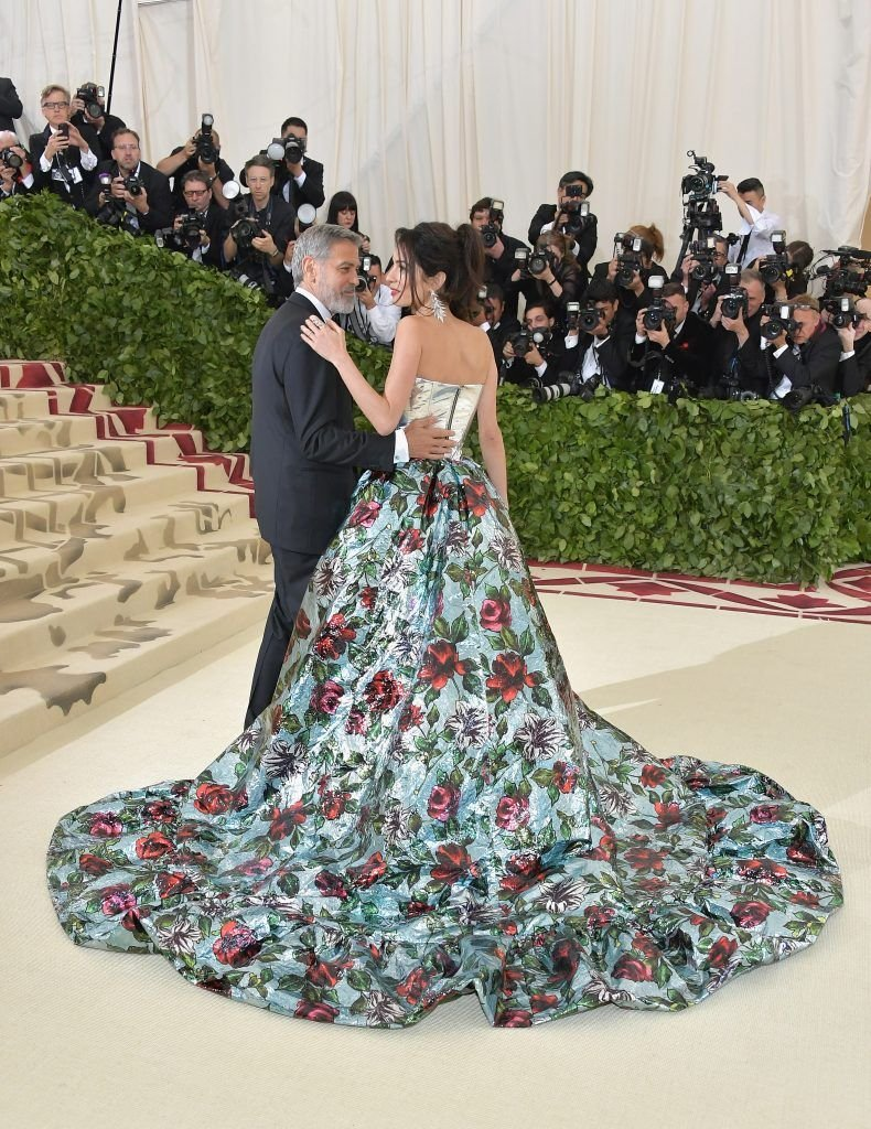 NEW YORK, NY - MAY 07:  George Clooney and Amal Clooney attend the Heavenly Bodies: Fashion & The Catholic Imagination Costume Institute Gala at The Metropolitan Museum of Art on May 7, 2018 in New York City.  (Photo by Neilson Barnard/Getty Images)