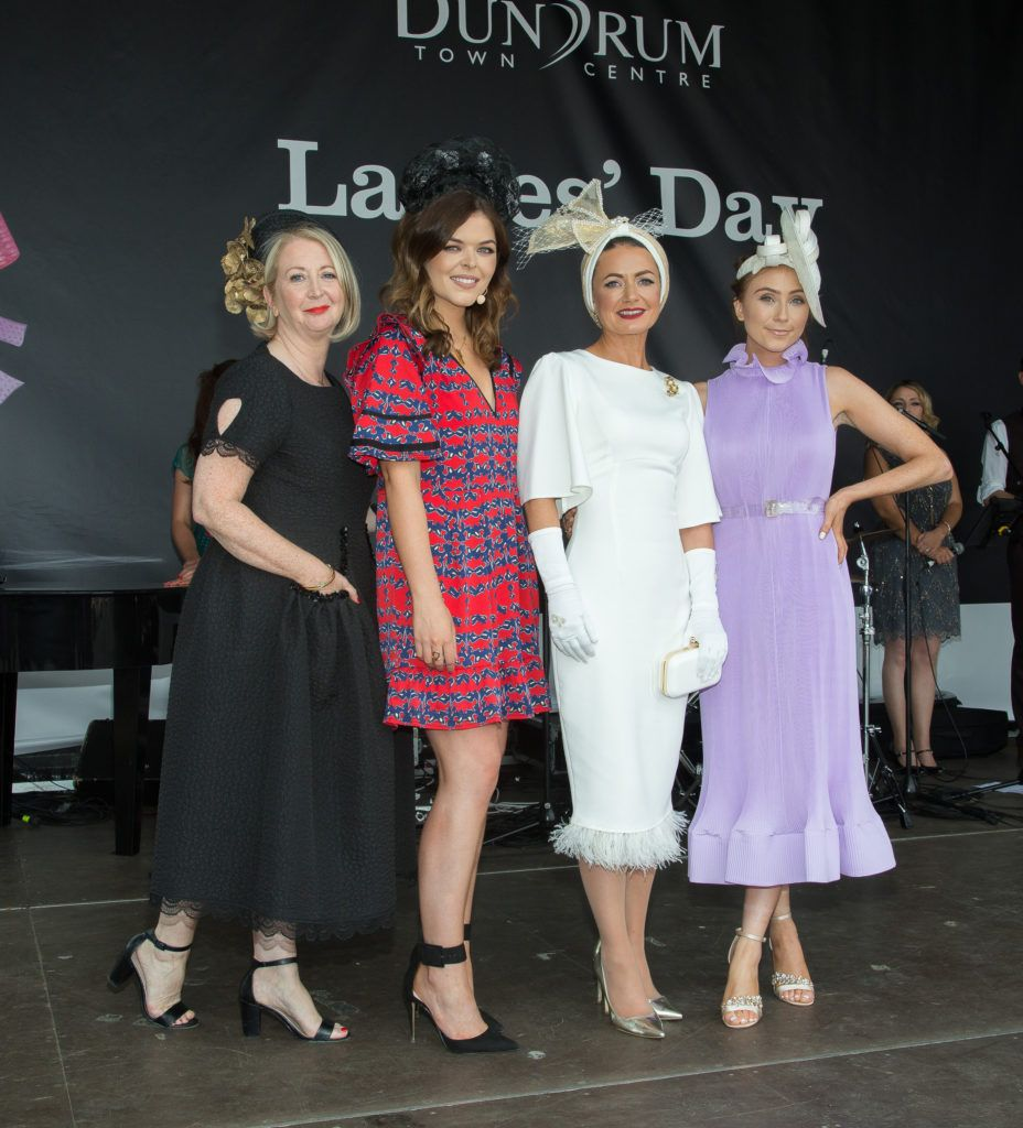 MC Doireann Garrihy, judges Bairbre Power & Erika Fox with Deirdre Kane of Carlow named 'best dressed' at the Dundrum Town Centre Ladies' Day at the Dublin Horse Show. Photo: Anthony Woods