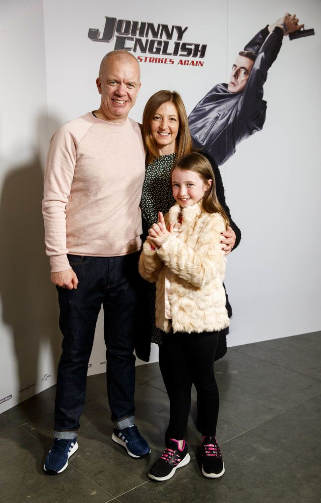 Gary, Karen and Emma Cosgrave (8) from Stillorgan pictured at a special preview screening of Johnny English Strikes Again at ODEON Point Village, Dublin. Picture Andres Poveda