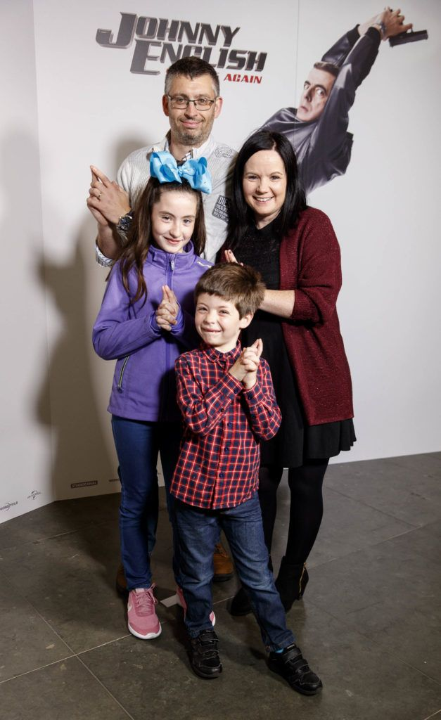 Niall, Nina and Sara (11) and Eoin Burke (6) pictured at a special preview screening of Johnny English Strikes Again at ODEON Point Village, Dublin. Picture Andres Poveda