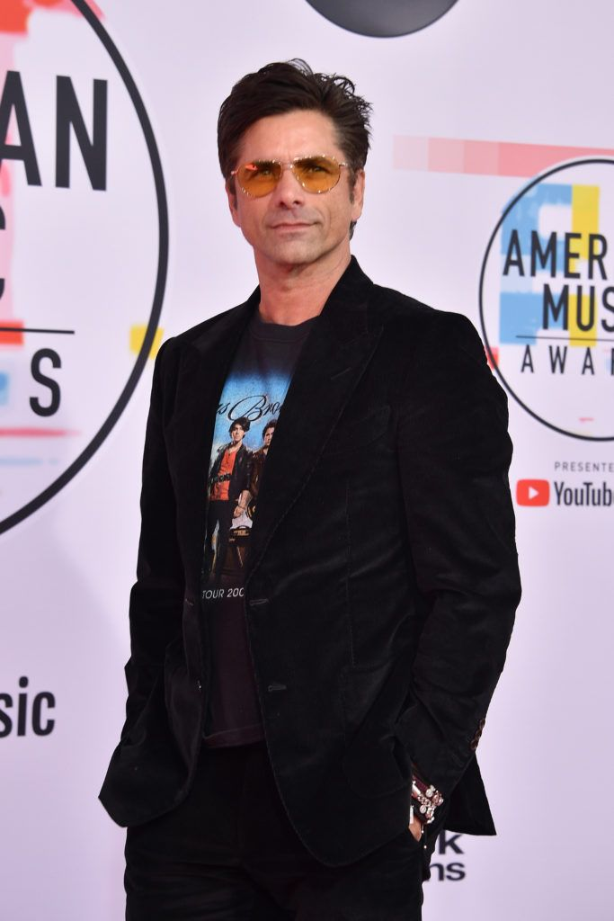 John Stamos attends the 2018 American Music Awards at Microsoft Theater on October 9, 2018 in Los Angeles, California.  (Photo by David Crotty/Patrick McMullan via Getty Images)