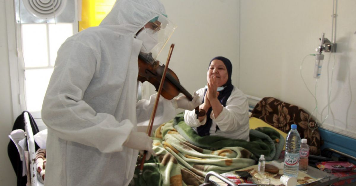 Fiddler on the wards: Violin-playing doctor cheers Covid patients in Tunisia