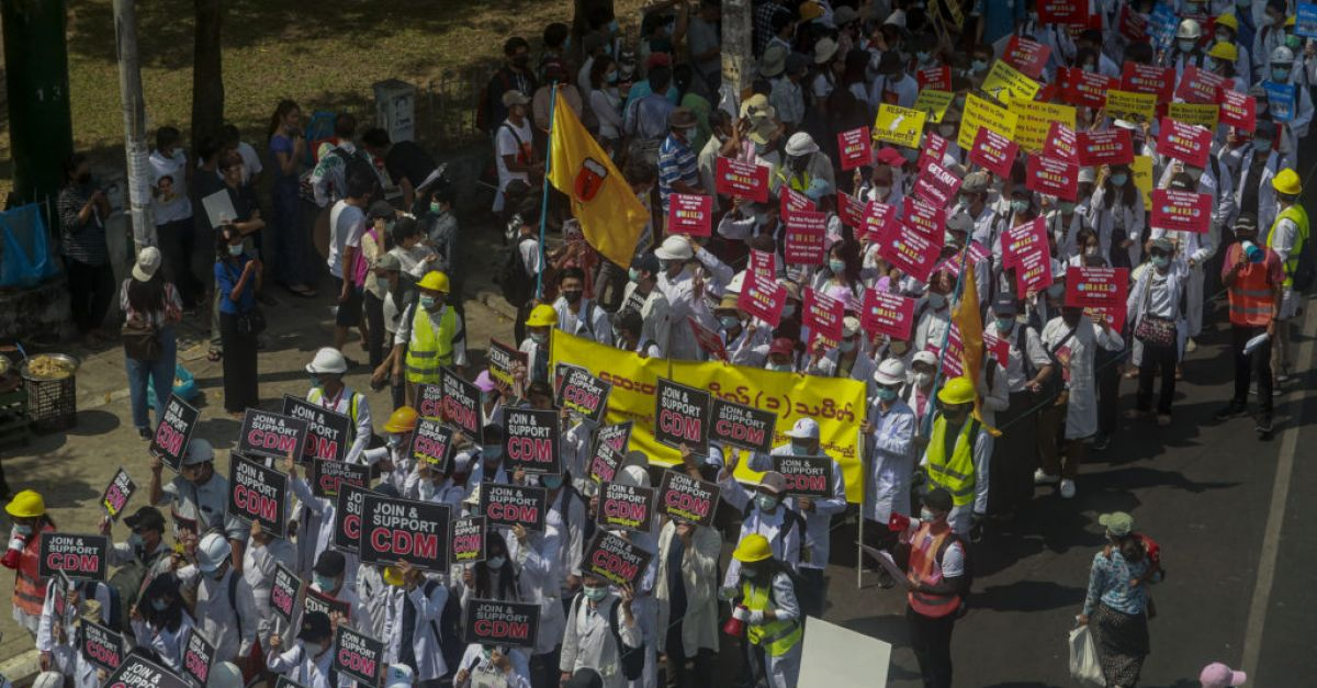 Pro-military marchers attack anti-coup protesters in Myanmar