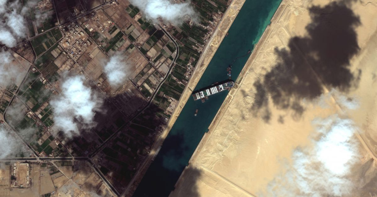 Two more tugboats join bid to free cargo ship stuck in Suez Canal