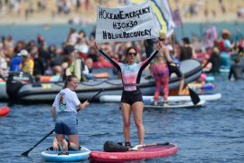 Protesters Take To Canoes And Surfboards To Urge G7 Leaders To Save Seas