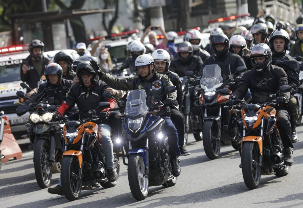 Bolsonaro fined for failing to wear mask during motorbike procession