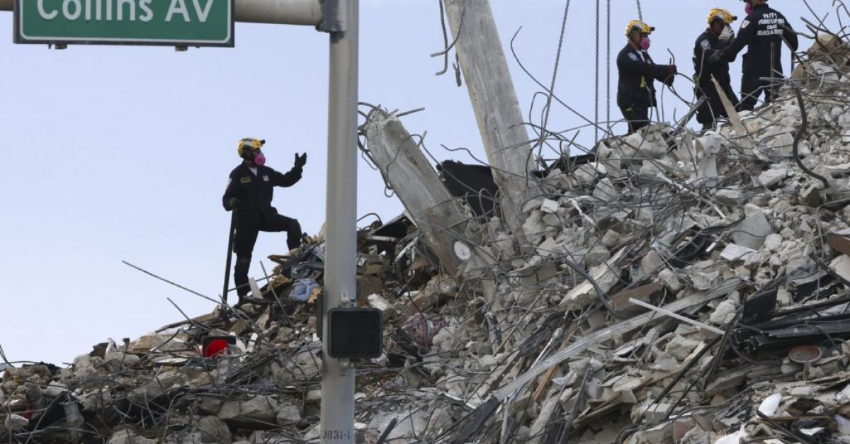 Tropical storm threatens renewed search at site of collapsed high-rise