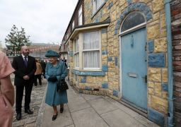 Britain's Queen Pays Visit To Set Of Coronation Street