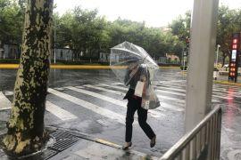 Typhoon Leaves Roads Waterlogged In Shanghai