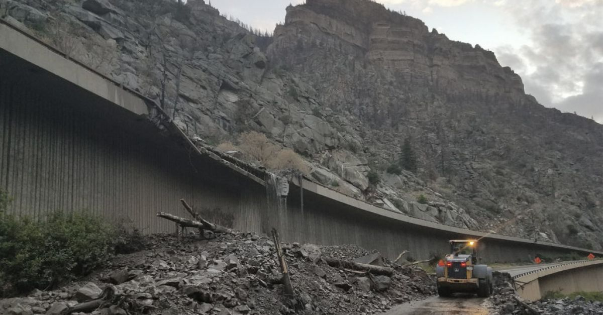 Mudslides force dozens of motorists to spend night on motorway and in tunnel