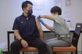 Japan To Limit Hospital Care As Covid-19 Cases Hit New High