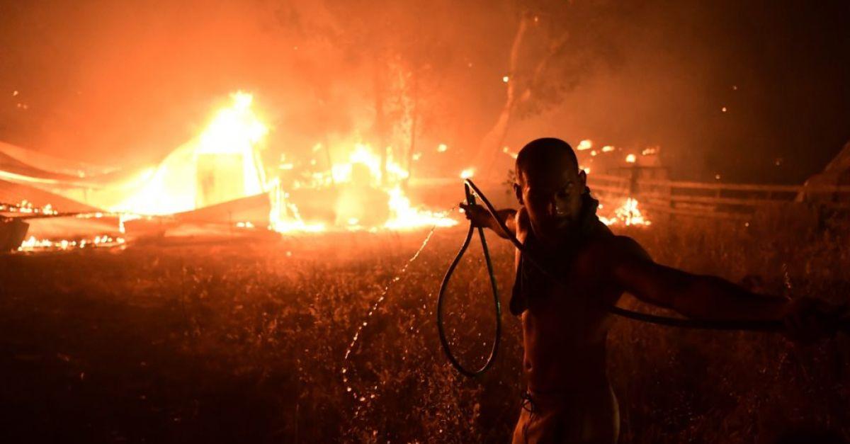 EU sends help as Greek island residents flee wildfire by sea