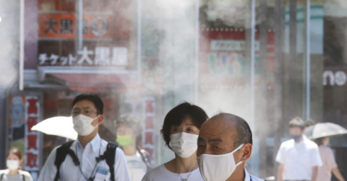 Tokyo reports record 5,042 cases as Covid infections surge during Olympics