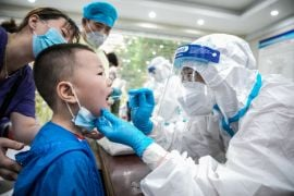 China Keeps Guard Up As Covid Outbreak Enters Fourth Week
