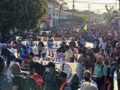 Thousands Of Migrants March Out Of City In Mexico Towards Us Border