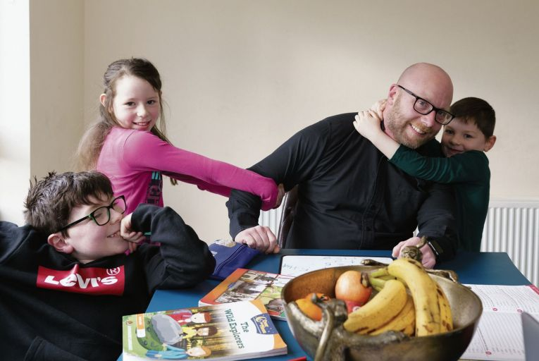 Dr Colman Noctor and his children, (from left) Ódhran, 10, Layla, 8, and Harry, 6, at their home in Carlow: homeschooling issues Picture: Barry Cronin