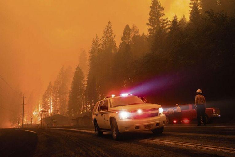 Californian firefighters survey a blazing fire in Plumas County last week. Picture: Getty