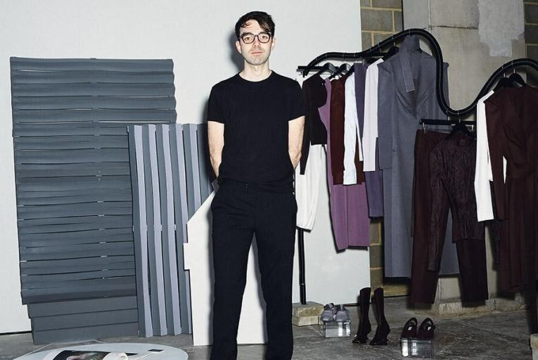 Andrew Bell and a selection of his designs at the RCA MA 2019 fashion exhibition
