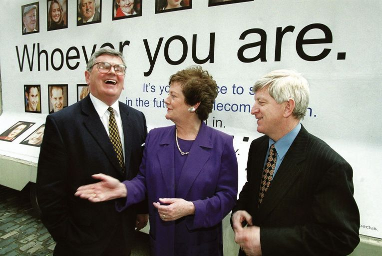 Mary O'Rourke, then Minister for Public Enterprise, shares a joke with Telecom Eireann chairman Ray McSharry (left) and chief executive Alfie Kane at the announcement of Telecom Eireann's initial share offering in 1999. Shown on Sold: The Eircom Shares Saga (RTÉ One). Picture: Photocall Ireland