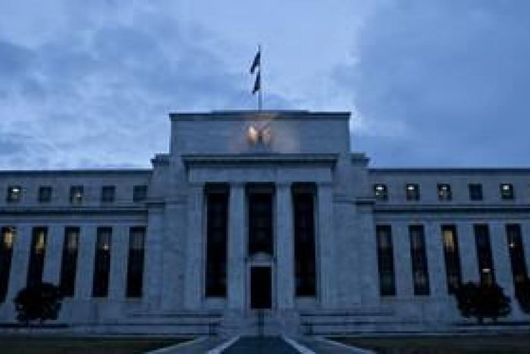Fed sees improving economy reducing need for stimulus