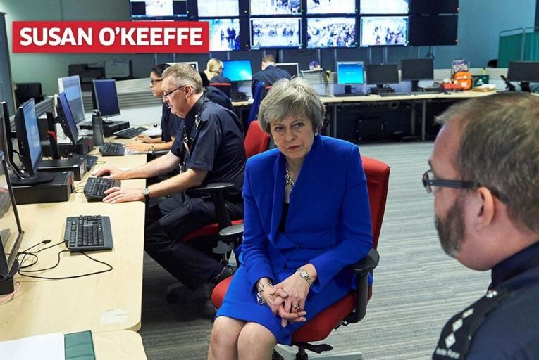 Theresa May talks to UK Border Force officers at  Heathrow Airport. Pic: Getty