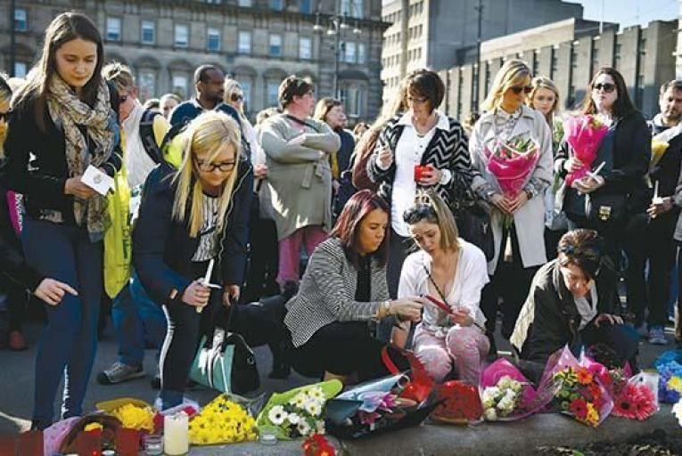 People attend a vigil in memory of murdered student Karen Buckley in George Square in Glasgow on Friday