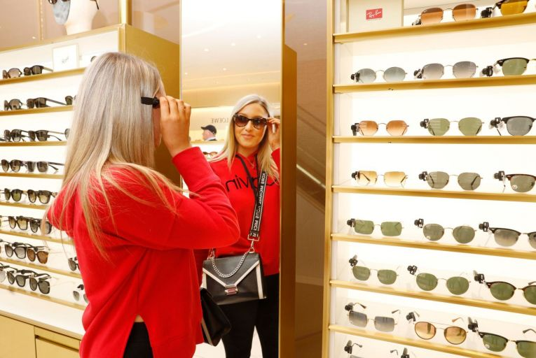Civa Connell tries on sunglasses at Brown Thomas in Dublin after it reopened this week. Changes in the rates businesses must pay would assist them as they recover from lockdown. Picture: Leon Farrell/Photocall Ireland
