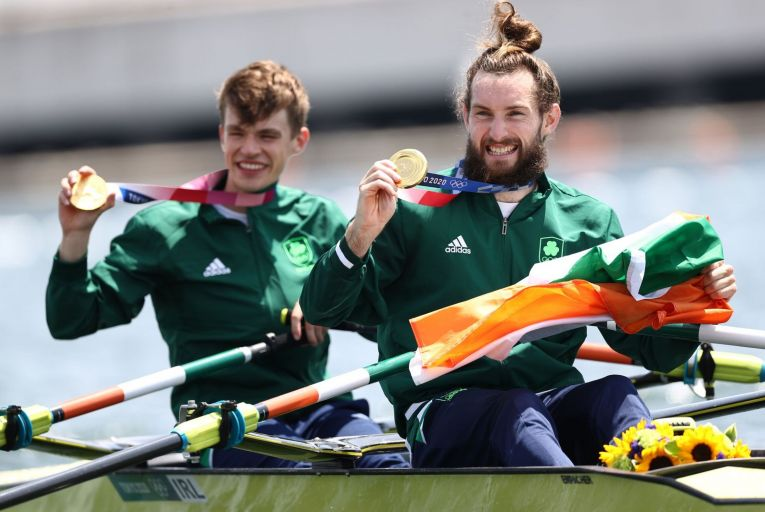 Gold medalists Fintan McCarthy and Paul O\'Donovan pose with their medals after the Lightweight Men\'s Double Sculls Final at the Tokyo Olympics. Picture: Maja Hitij/Getty Images