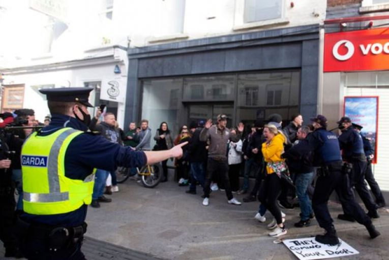 Gardaí take action during an anti-lockdown march on Grafton Street in Dublin on Saturday. Photo: RollingNews.ie