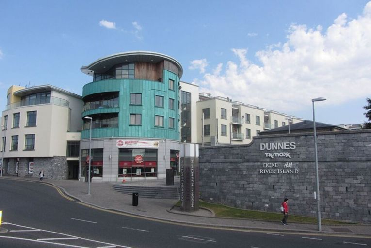 The apartments are fully let and located above the popular, mixed-use MacDonagh Junction Shopping Centre in the city centre